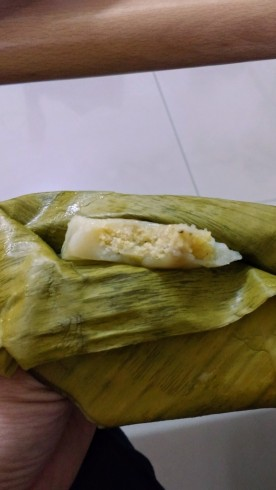 Sticky rice and something in banana leaf...